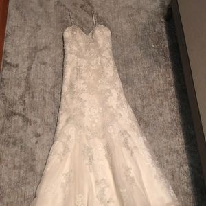 Ivory, lace, and beaded wedding gown